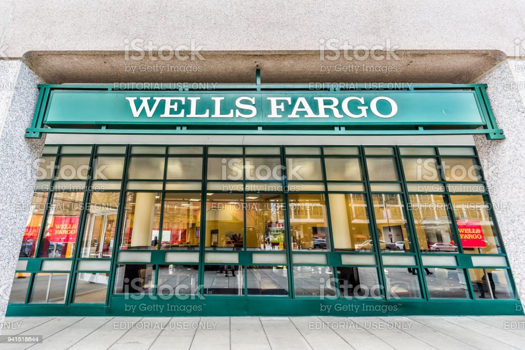 Wells Fargo bank entrance with green sign in downtown city, nobody stock photo