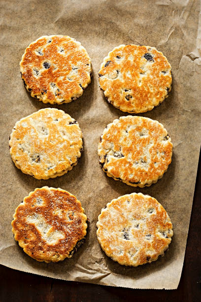 Welsh cake with currants and sugar Welsh cake with currants and sugar welsh culture stock pictures, royalty-free photos & images
