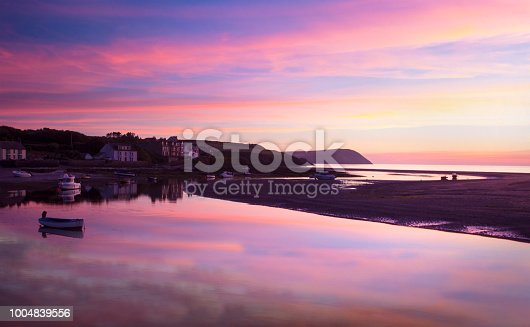 Sunset over small harbour in Pembrokeshire, Wales