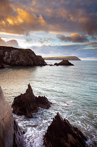 Sunset over rocky coastline in Pembrokeshire, Wales