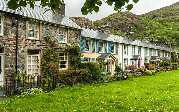 Welsh Cottages Cottages in the village of Beddgelert, Snowdonia with hills in the background. wales stock pictures, royalty-free photos & images