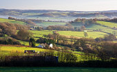 Classic Welsh countryside of fields, rolling hills and farmhouse - Monmouthshire, Wales