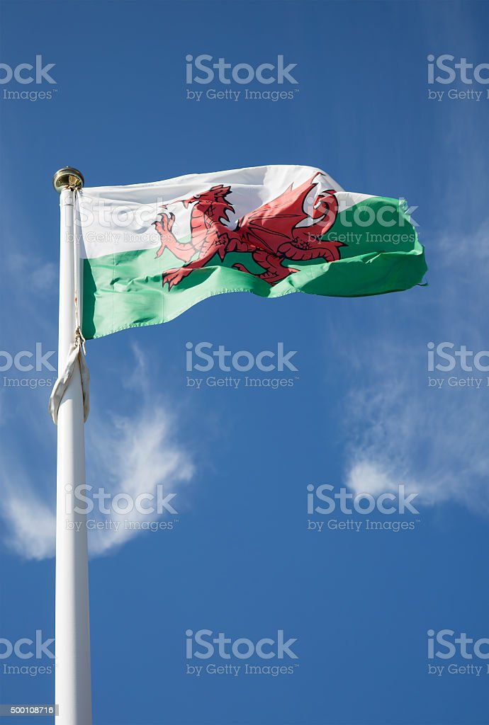 Welsh flag on a blue sky background stock photo