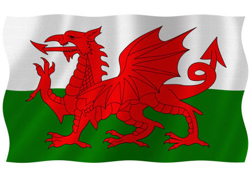 Flag of wales waving with highly detailed textile texture pattern