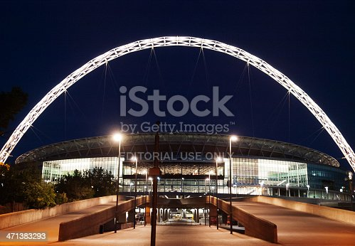 London, United Kingdom - May 22, 2009 : Brightly lit Wembley Stadium at night with people in front