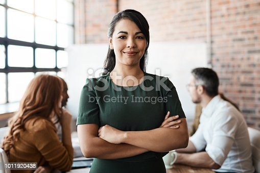 Portrait of a confident businesswoman standing in the boardroom during a meeting