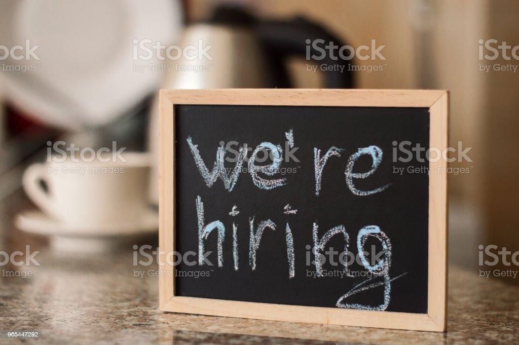 We'ra hiring notice on a small blackboard. Restaurant, cafe or bar background zbiór zdjęć royalty-free