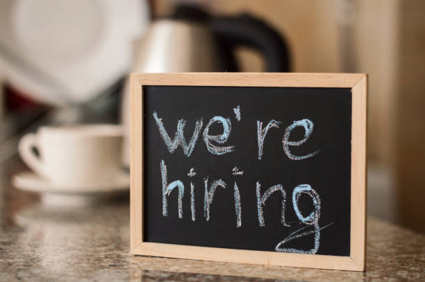 We'ra hiring notice on a small blackboard. Restaurant, cafe or bar background We'ra hiring notice on a small blackboard. Restaurant, cafe or bar background help wanted sign stock pictures, royalty-free photos & images