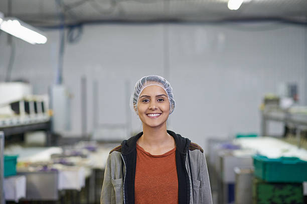 We're all about efficiency here Shot of a woman working in a food processing planthttp://195.154.178.81/DATA/i_collage/pu/shoots/805486.jpg hair net stock pictures, royalty-free photos & images