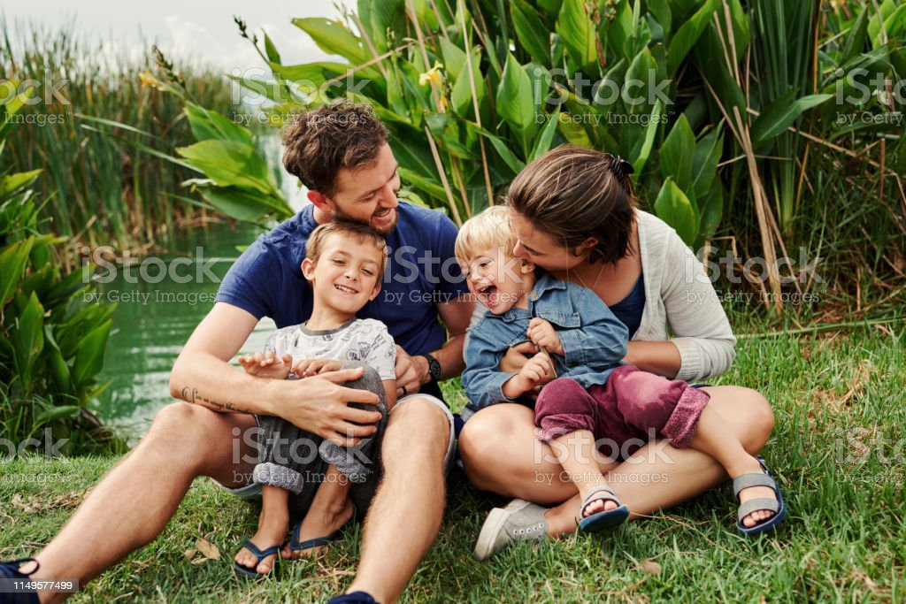 We're answering to natures call today Full length shot of a beautiful young family of four spending some time together outdoors Adult Stock Photo