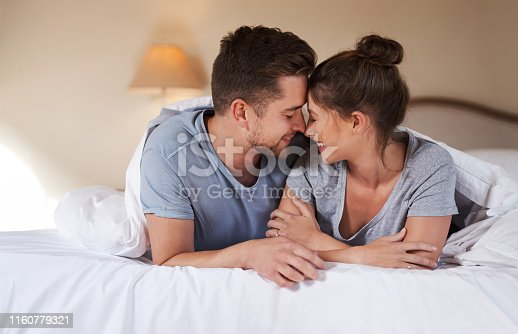 Shot of an affectionate young couple spending some quality time together in their bedroom at home