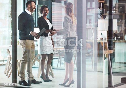 Shot of businesswomen shaking hands in a modern office