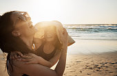 Shot of a young woman spending the day at the beach with her daughter