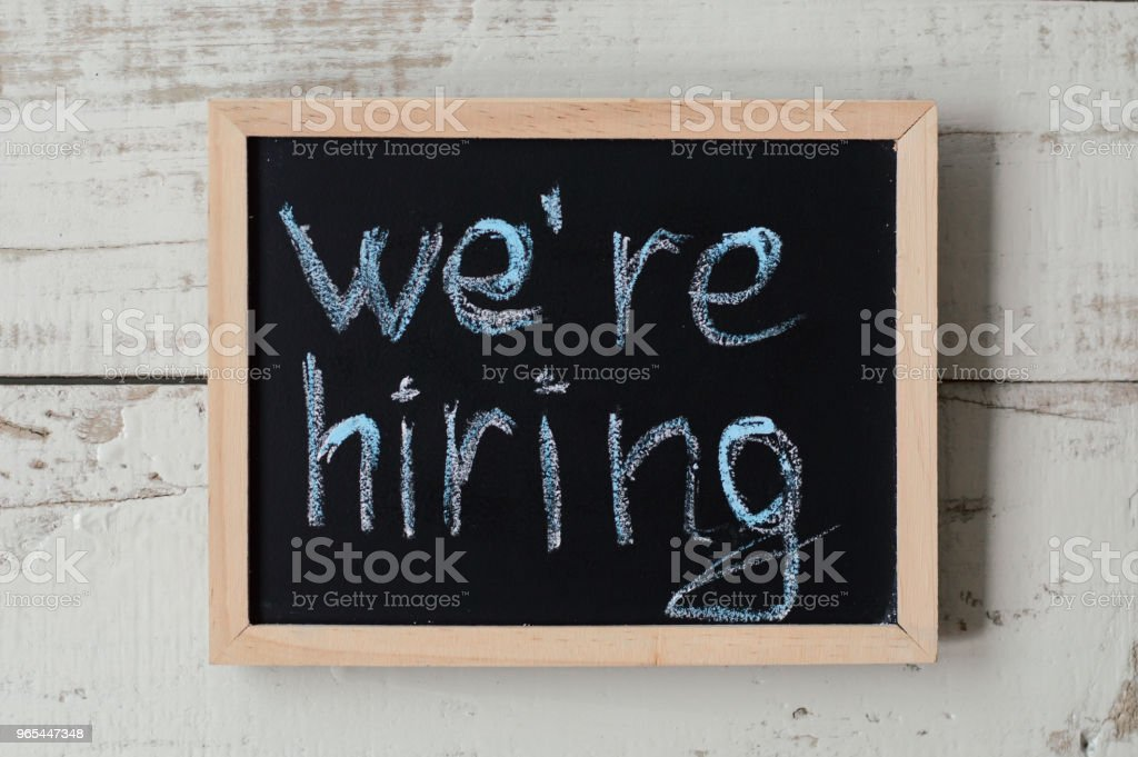 We're hiring banner. Blackboard with announcement of hiring. Work opportunities royalty-free stock photo