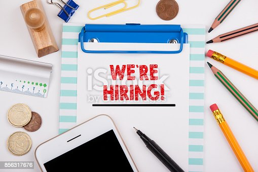 istock We`re hiring. career and a successful business background. Office desk with stationery and mobile phone 856317676