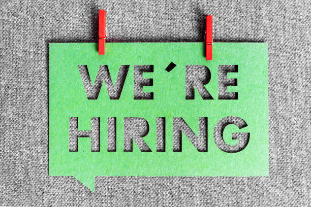 """""""We're hiring"""" green banner on grey texture background. Job vacant and employment concept. """"We're hiring"""" green banner on grey texture background. Job vacant and employment concept. help wanted sign stock pictures, royalty-free photos & images"""