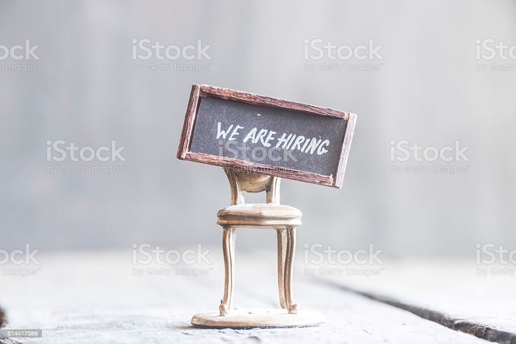 We're hiring idea, text and chair, retro style. stock photo