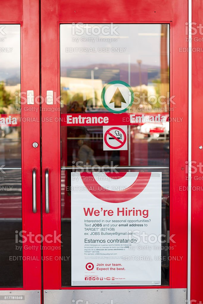 'We're Hiring' Sign on the Door at Target stock photo