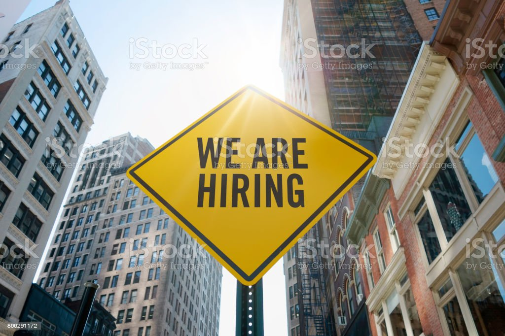 'we're hiring' traffic sign stock photo