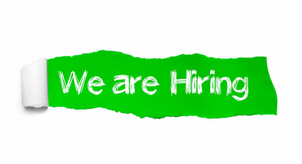 We're Hiring written under torn paper. Human resource concept. Concept Image We're Hiring written under torn paper. Human resource concept. Concept Image. help wanted sign stock pictures, royalty-free photos & images