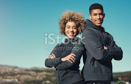 Portrait of a happy young couple out for a run