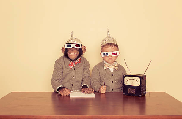 We're Listening A young boy and his chimpanzee friend are trying to communicate with higher intelligence. 3 d glasses stock pictures, royalty-free photos & images