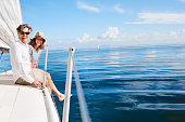 Full length portrait of an affectionate mature couple enjoying a boat cruise out on the ocean