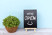 istock We're open sign on black board 1253674096