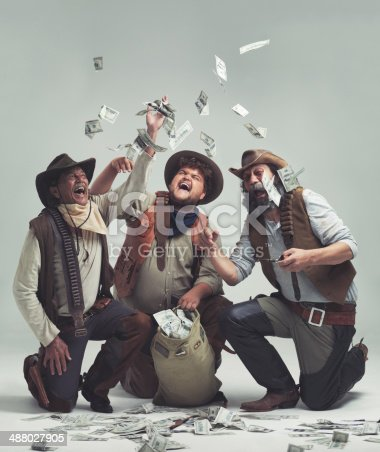 A group of bandits celebrating a robbery together
