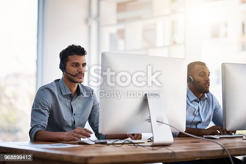 Shot of call centre agents working in an office
