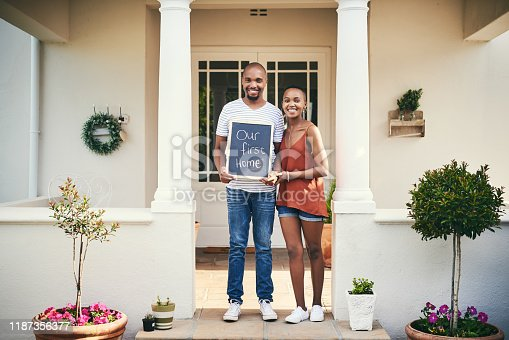 Portrait of a young couple holding a chalkboard with