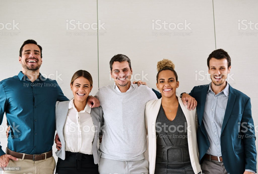 We're team players with the golden mission of reaching success stock photo