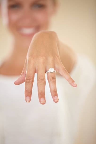 we're tying the knot - diamond ring hand stock photos and pictures