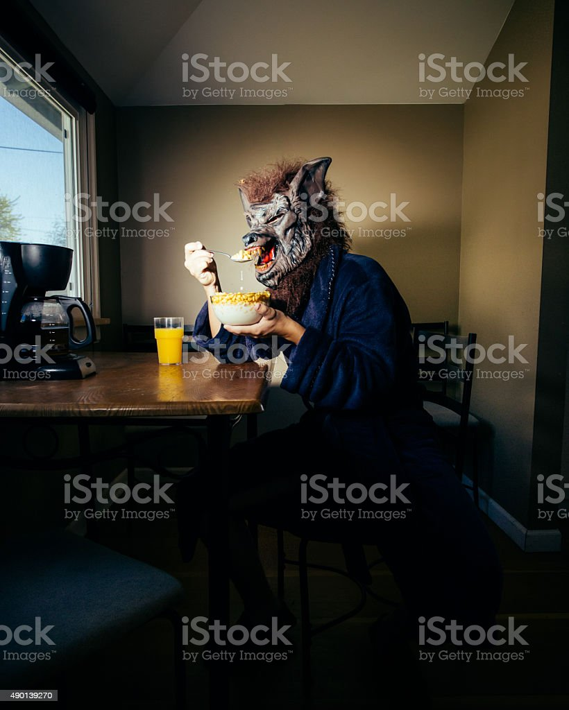 Werewolf Man Eating Breakfast On a Lazy Weekend Morning stock photo