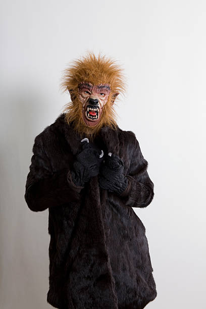 werewolf woman and fur coat - wolf maske stock-fotos und bilder
