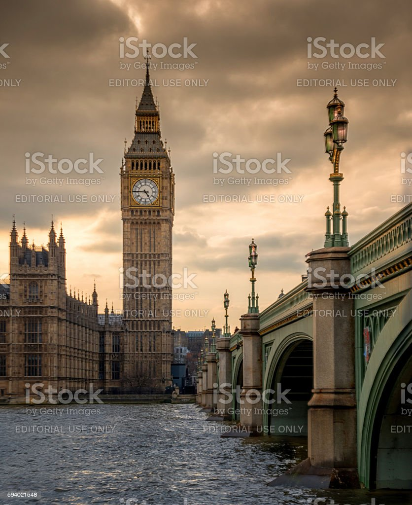 Wesminster Bridge crossing the river Thames to Big Ben stock photo