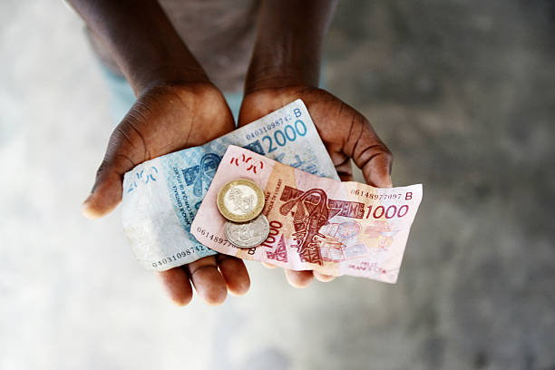 west african money west african money CFA, used in west african french speaking countries (10000 is about $20) côte d'ivoire stock pictures, royalty-free photos & images