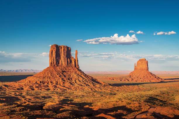 West and East Mitten Butte Monument Valley Arizona USA stock photo
