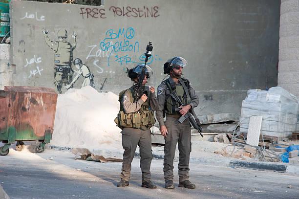 Cisgiordania occupazione militare israeliana e Banksy Murale - foto stock