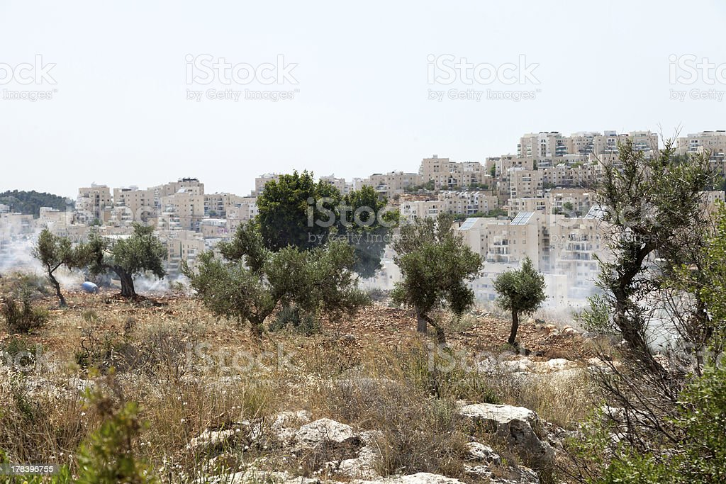 West Bank Settlements and Tear Gas in Palestinian Field royalty-free stock photo