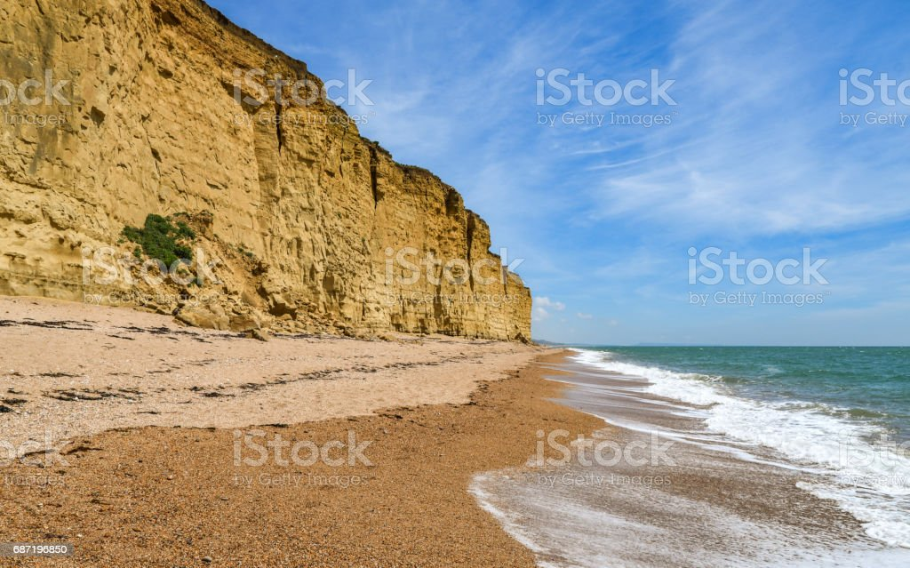 West Bay cliffs, beach and coastline in Dorset, England stock photo