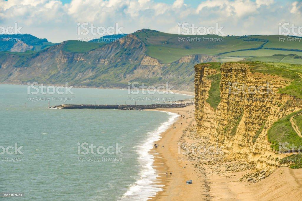 West Bay coastline and groyne  in Dorset, England stock photo