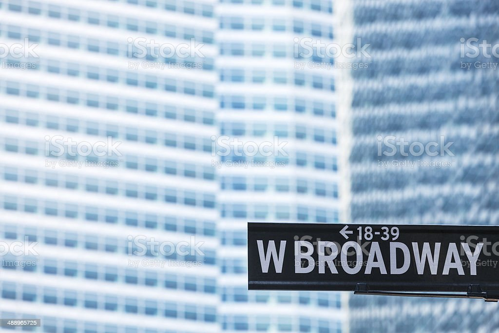 West Broadway Street Sign Against Financial Building stock photo