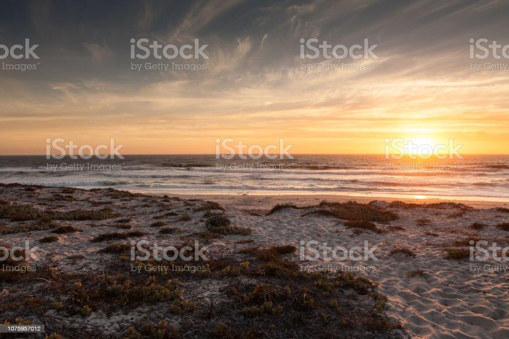 Westkust zonsondergang foto