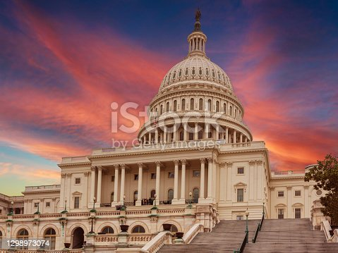 istock West Façade of the US Capitol Building at Sunset, Washington DC, USA. 1298973074