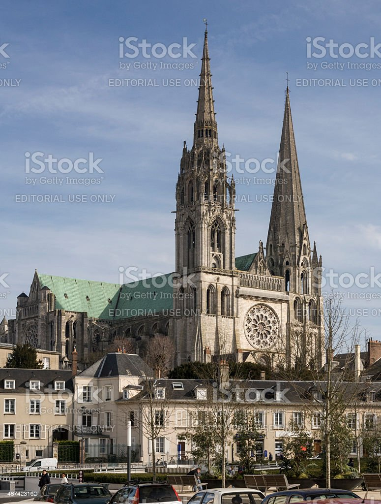 West Front of Chartres Cathedral stands above the modern town stock photo