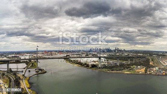 Australia, Melbourne - December 02, 2018: Aerial view of the West Gate Bridge and Melbourne city skyline with dark storm clouds
