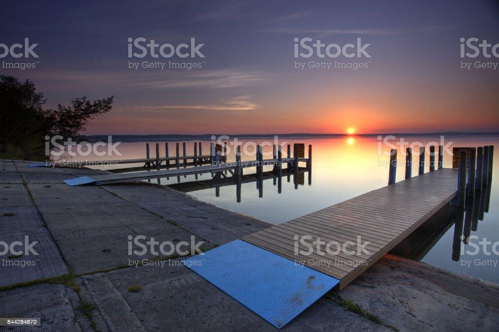 West Higgin Lake Boat Launch summer sunrise stock photo