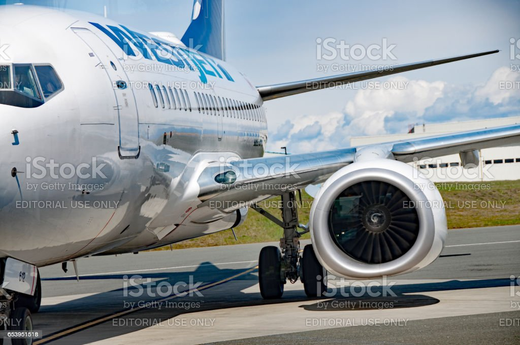 West Jet commericial airline unloading in Comox,  British Columbia stock photo