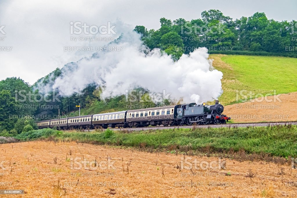 West Somerset Railway steam tour train in countryside stock photo